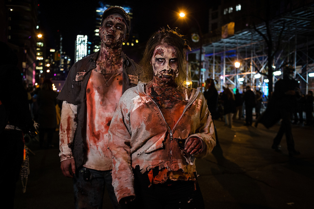 New York, NY - 31 October 2016. Ywo men costumed as bloody zombies  in the Greenwich Village Halloween Parade.