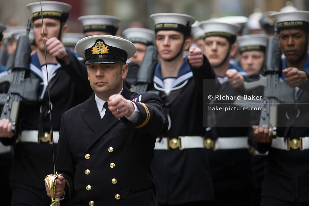 London 17/4/13 - Royal Navy sailors march before the funeral of Margaret Thatcher. Draped in the union flag and mounted on a gun carriage, the coffin of ex-British Prime Minister Baroness Margaret Thatcher's coffin travels along Fleet Street towards St Paul's Cathedral in London, England. Afforded a ceremonial funeral with military honours, not seen since the death of Winston Churchill in 1965, family and 2,000 VIP guests (incl Queen Elizabeth) await her cortege.