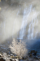 Sunlight Shining Through Rising Mist at Burney Falls, McArthur-Burney Falls Memorial State Park, California<br /> <br /> Backstory:<br /> It is worth noting that I photographed this scene during an extreme drought year. This was in mid-January with zero snow in sight. In fact, nearby Lassen Volcanic National Park was still open for the season! Fortunately Burney Falls has plenty of water year-round.<br /> <br /> Year Photographed: 2014