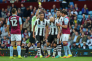 Newcastle United striker Jonjo Shelvey (12) is shown a yellow card, booked 0-0 during the EFL Sky Bet Championship match between Aston Villa and Newcastle United at Villa Park, Birmingham, England on 24 September 2016. Photo by Alan Franklin.