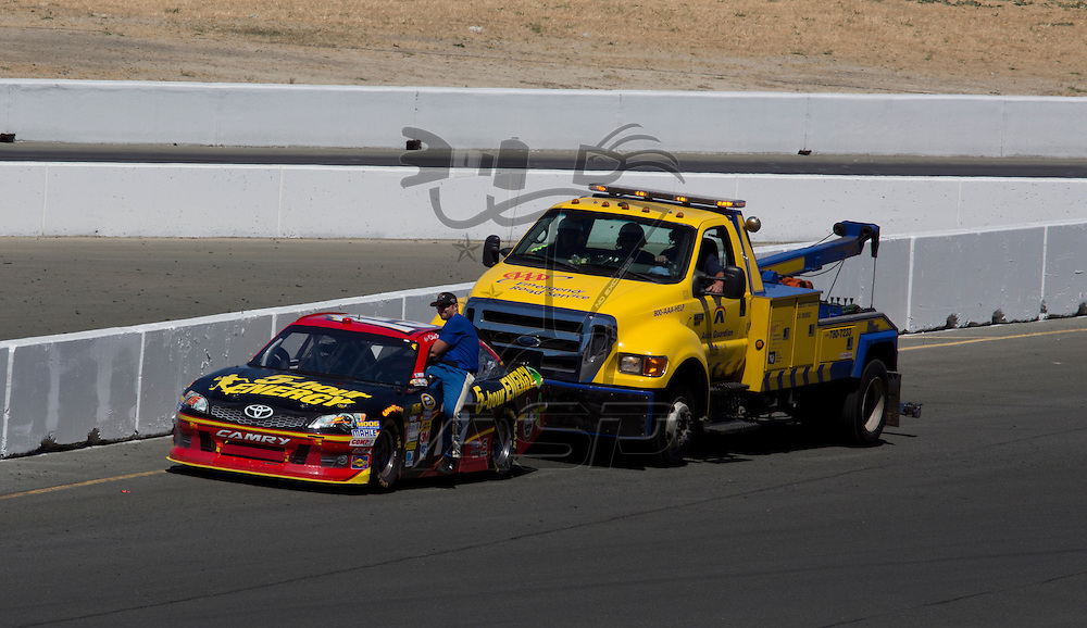 SONOMA, CA - JUN 24, 2012: Clint Bowyer (15) runs out of fuel after winning the Toyota Save Mart 350 at the Raceway at Sonoma in Sonoma, CA.