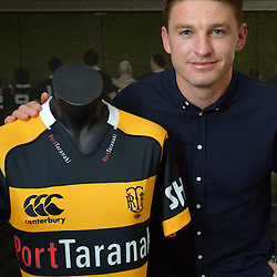 Beauden Barrett (pictured with the Taranaki jersey)  announces his re-signing with the All Blacks, Hurricanes and Taranaki RFU at the New Zealand Rugby Union Head Office, Wellington, New Zealand on Monday, 29 August 2016. Photo: Dave Lintott / lintottphoto.co.nz
