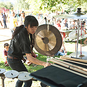 Percussionist Joy Liu performs in the West Coast premiere of Inuksuit at the 66th Ojai Music Festival on June 7, 2012 in Ojai, California.