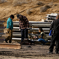 Gallup police detectives and medical investigators inspect a body that was found near the BNSF rail yard in Gallup Thursday.