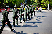 "Soldiers marching at the entrance to the  ""The Forbidden City"" which was the Chinese imperial palace from the Ming Dynasty to the end of the Qing Dynasty. It is located in the middle of Beijing, China. Beijing is the capital of the People's Republic of China and one of the most populous cities in the world with a population of 19,612,368 as of 2010."