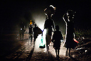 Families fleeing the murderous night raids perpetrated by the LRA. Each night the families, known as night walkers, leave their villages and head for the relative safety of larger towns, returning home in the early morning. This continuing violence (since 1987) is one of Africa's longest running conflicts. <br /> <br /> Northern Uganda