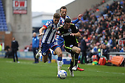 Wigan Athletic defender Reece Burke (32) and Brighton & Hove Albion winger Jamie Murphy (15) during the EFL Sky Bet Championship match between Wigan Athletic and Brighton and Hove Albion at the DW Stadium, Wigan, England on 22 October 2016.