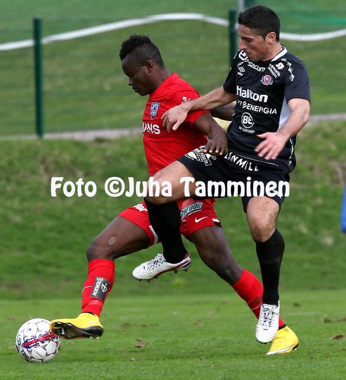 3.5.2015, Kisapuisto, Lahti.<br /> Veikkausliiga 2015.<br /> FC Lahti - FC Inter Turku.<br /> Vincent Onovo (Inter) v Xhevdet Gela (FC Lahti).