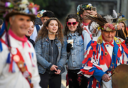 "© Licensed to London News Pictures. 01/05/2018. Oxford, UK. Members of the public watch Morris dancers in dress  dance next to Hertford Bridge, often called ""the Bridge of Sighs"" in Oxford, Oxfordshire as part of May Day celebrations. Students were again prevented from jumping from Magdalen Bridge in to the river, which has historically been a tradition, due to injuries at a previous years event . Photo credit: Ben Cawthra/LNP"