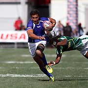 Reupena Levasa eludes a South African defender in Manu Samoa's 7-12 loss in the Cup Semi Final af the USA Sevens Rugby at Sam Boyd Stadium, Las Vegas, Nevada, USA.  Photo by Barry Markowitz, 2/10/13.  Courtesy Samoa Tuna Processors/Tri Marine