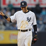 Derek Jeter, New York Yankees, fielding at shortstop during the New York Yankees V Baltimore Orioles home opening day at Yankee Stadium, The Bronx, New York. 7th April 2014. Photo Tim Clayton