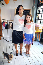 YASMIN MILLS and her daughter MADDIE at the 10th anniversary party of the store Caramel, Ledbury Road, London W11.  The party was held in association with the Naked Heart Foundation - a charity set up by model Natalia Vodianova.