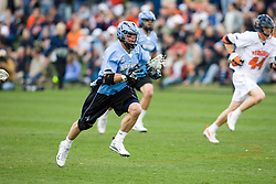 Johns Hopkins midfielder Stephen Peyser (12) runs up field after winning a faceoff.  The #2 ranked Virginia Cavaliers defeated the #6 ranked Johns Hopkins Blue Jays 13-12 in overtime at the University of Virginia's Klockner Stadium in Charlottesville, VA on March 22, 2008.  The loss, in front of a record UVA crowd of 7,500, was the third consecutive overtime defeat for Hopkins, the defending national champions.