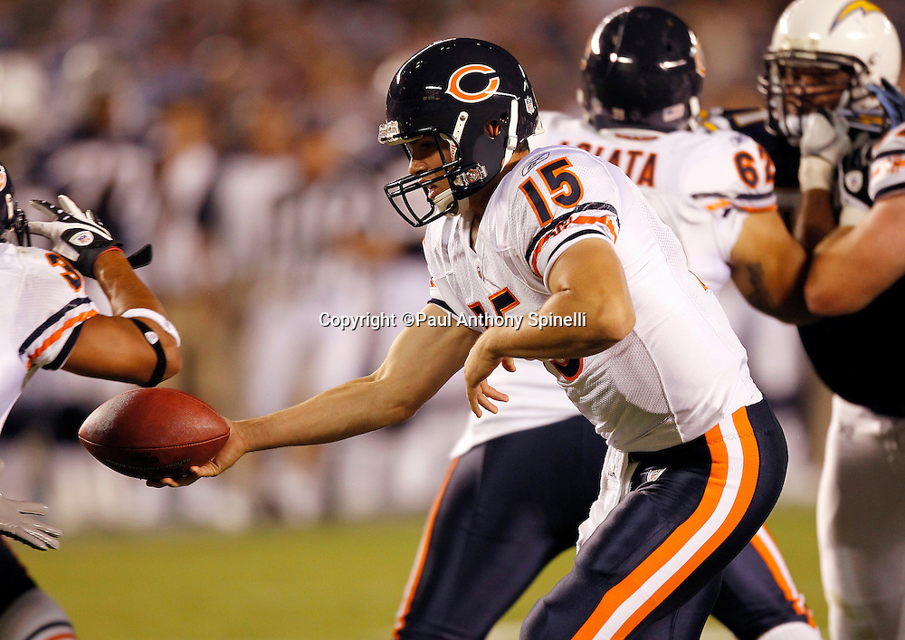Chicago Bears rookie quarterback Dan LeFevour (15) hands off the ball on a running play during a NFL week 1 preseason football game against the San Diego Chargers, Saturday, August 14, 2010 in San Diego, California. The Chargers won the game 25-10. (©Paul Anthony Spinelli)
