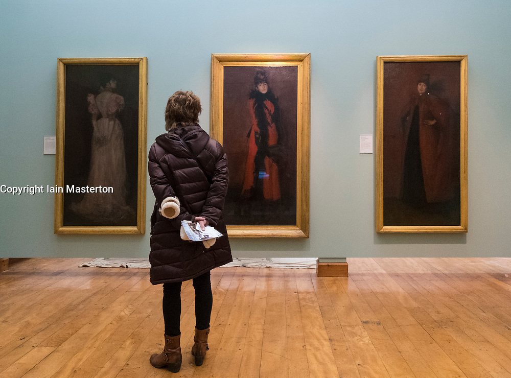 Visitor to Hunterian Art Gallery looking at paintings by James Abbott McNeill Whistler at Glasgow University, Scotland, United Kingdom