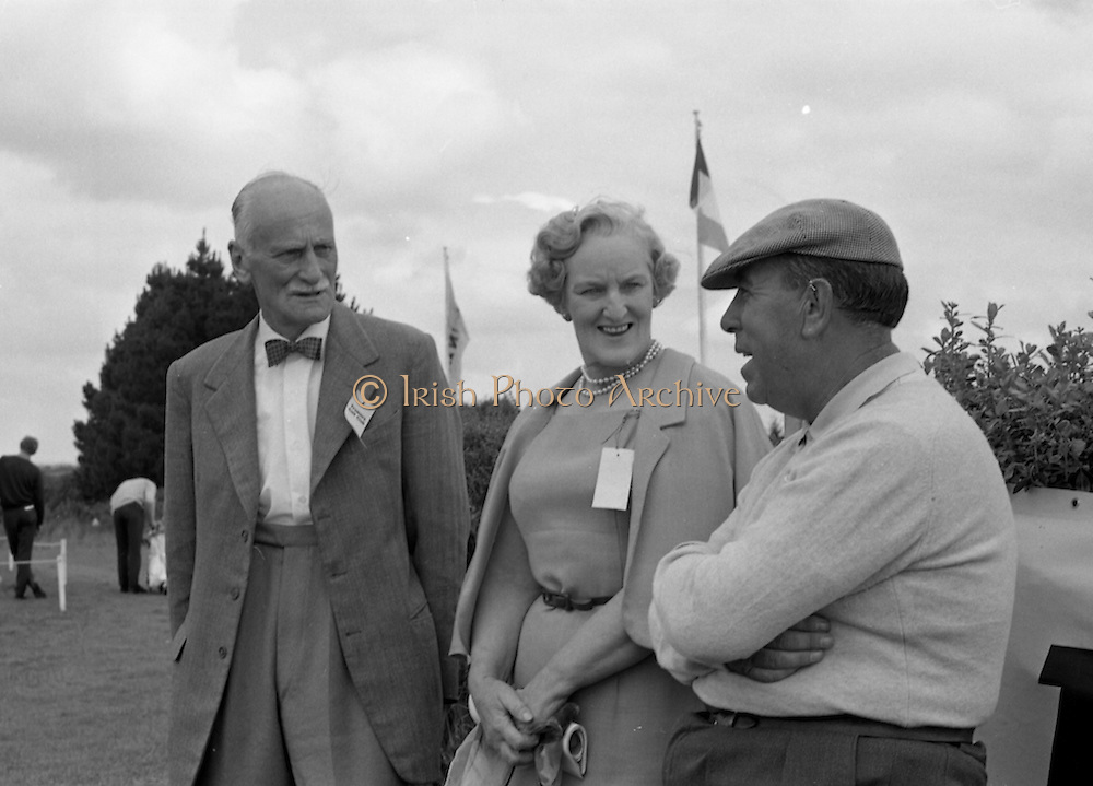 Harry Bradshaw (right) relaxes with Mr. and Mrs Walter Stockpile while awaiting his starting time at the Irish Dunlop £1,000 Tournament at Tramore Golf Club, Co. Waterford on the 19th August 1967.