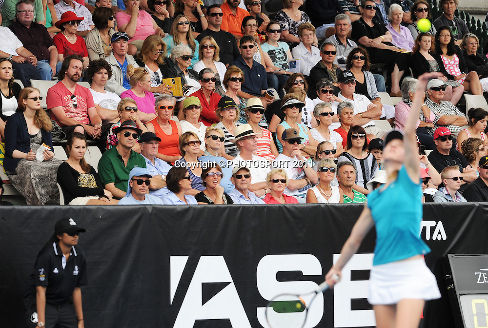 Tennis fans watch the action on day 3 at the 2012 ASB Tennis Classic at the ASB tennis centre, Stanley st. Auckland. Wednesday 4  January 2012 Photo: Andrew Cornaga/photosport.co.nz