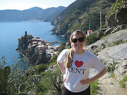 A Kent State student poses above a seaside town in Italy during her study abroad program.