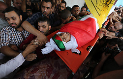 October 4, 2018 - Beit Lahia, Gaza Strip - Mourners carry the body of Palestinian Ahmed Abu Habel, 15, who was shot dead by Israeli troops during clashes in a demonstration against Israeli blockade on Gaza Strip, and the United States decision to stop funding and backing the United Nations agency for Palestinian refugees (UNRWA), at the Erez crossing with Israel, during his funeral in Beit Lahia in the northern Gaza Strip. (Credit Image: © Ashraf Amra/APA Images via ZUMA Wire)