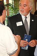 Phillip L. Parker of the DACC (right) during a Dayton Area Chamber of Commerce Business After Hours at the NCR Country Club in Kettering, Wednesday, July 25, 2012.  The Chamber will hold the 2012 Chamber Challenge, their 20th annual golf tournament and silent auction, at the NCR Country Club in September.
