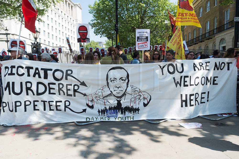 © Licensed to London News Pictures. 15/05/2018. Kurdish demonstrators take part in a protest in Whitehall as President of Turkey Recep Tayyip Erdoğan meets Briitsh Prime Minister Theresa May at No.10 Downing St during a three day visit to the UK. London, UK. Photo credit: Ray Tang/LNP