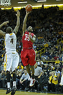 January 04 2010: Ohio State Buckeyes guard/forward David Lighty (23) puts up a shot over Iowa Hawkeyes guard/forward Roy Devyn Marble (4) during the second half of an NCAA college basketball game at Carver-Hawkeye Arena in Iowa City, Iowa on January 04, 2010. Ohio State defeated Iowa 73-68.