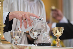 20 April 2019, Jerusalem: Deacon Della Wells pours holy water into the wine in preparation for Holy Communion, during Easter Sunday service at the Cathedral Church of Saint George the Martyr, Jerusalem.
