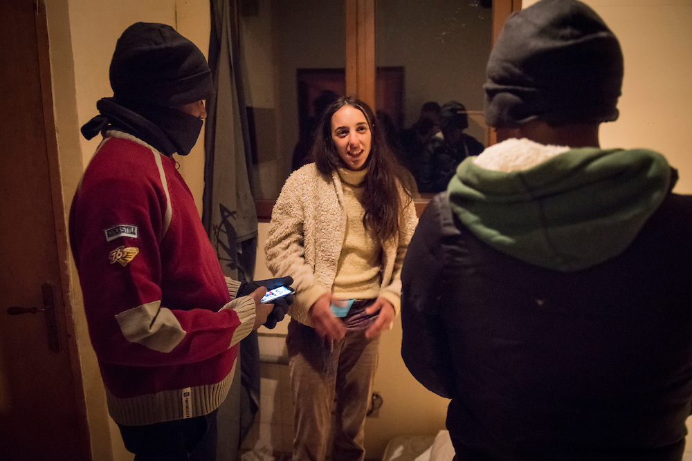 November 7, 2016,  Breil-sur-Roya, French Alpes, France. &Eacute;lo&iuml;se shows two Eritrean migrants where they can sleep in her house.   She picked up the 5 refugees when they walked on the road, and will shelter them in her home for one night. She is married, a mother of 2 young children,  and does not hesitate to welcome migrants in her farm house.<br /> <br /> 7 novembre 2016, Breil-sur-Roya, Alpes fran&ccedil;aises, France. &Eacute;lo&iuml;se montre &agrave; deux migrants &eacute;rythr&eacute;ens o&ugrave; ils peuvent dormir dans sa maison. Elle a trouv&eacute; 5 r&eacute;fugi&eacute;s sur la route, et les h&eacute;berge dans sa maison pour une nuit. Elle est mari&eacute;e, m&egrave;re de 2 jeunes enfants, et n'h&eacute;site pas &agrave; accueillir des migrants chez elle.