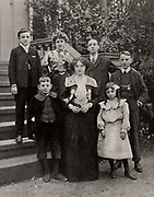 Dan Leno (1860-1904) born George Wild  Galvin. Popular English cockney comedian and pantomime dame.  Leno with his wife and family in 1903 after his recovery from illness.