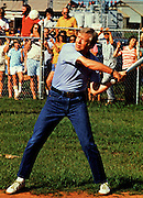 Jimmy Carter plays softball in his hometown of Plains, Georgia. Carter was pitcher and captain of his team that was comprised of off duty U.S. Secret Service agents and White House staffers. The opposing team was comprised of members of the White house traveling press and captained by Billy Carter, the president's brother. - To license this image, click on the shopping cart below