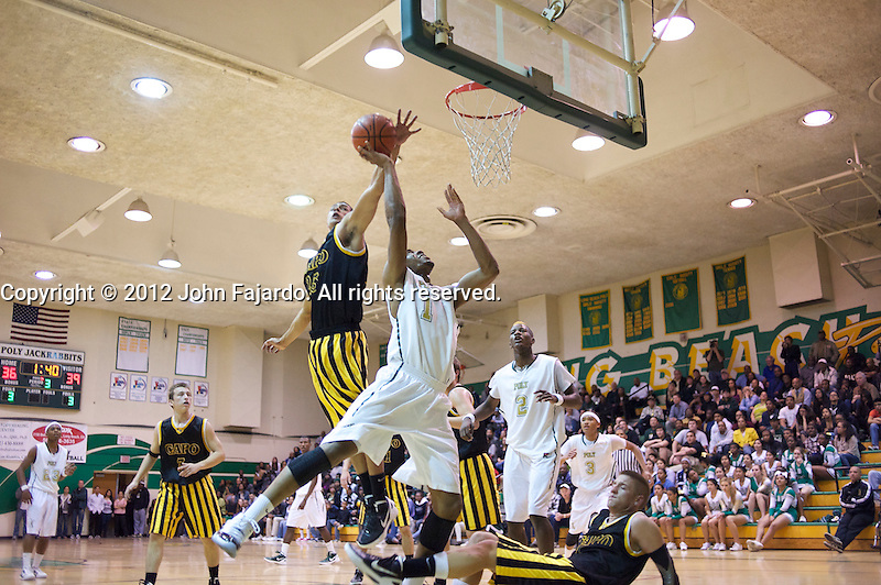 Poly's Roschon Prince is blocked by Jacob Short in the first round of the CIF State Boys Div I Basketball Tournament at Ron Palmer Pavilion, Long Beach, Calif., Wed, March 7, 2012.
