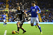 Leeds United midfielder Kemar Roofe (7) on the attack tracked by Birmingham City defender Maxime Colin (5) 0-0 during the EFL Sky Bet Championship match between Birmingham City and Leeds United at St Andrews, Birmingham, England on 30 December 2017. Photo by Alan Franklin.