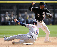 CHICAGO - APRIL 24:  Alexei Ramirez #10 of the Chicago White Sox forces Lonnie Chisenhall # 8 of the Cleveland Indians at second base on April 24, 2013 at U.S. Cellular Field in Chicago, Illinois.  The White Sox defeated the Indians 3-2.  (Photo by Ron Vesely)   Subject: Alexei Ramirez