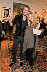 MAX ROGERS and KIMBERLY WYATT at a party to celebrate the launch of the first European John Varvatos Store, 12-13 Conduit Street, London held on 3rd September 2014.