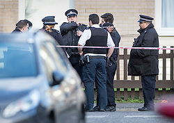 © Licensed to London News Pictures. 07/03/2019. London, UK. Police gather at the entrance to a block of flats near the crime scene in North Birkbeck Road in Leyton in east London where a murder investigation has been launched after a man in his twenties was stabbed on Wednesday. Photo credit: Peter Macdiarmid/LNP