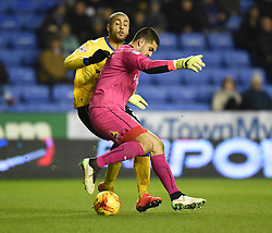 Wigan Athletic's Leon Clarke tussles with Reading's Adam Federici - Photo mandatory by-line: Paul Knight/JMP - Mobile: 07966 386802 - 17/02/2015 - SPORT - Football - Reading - Madejski Stadium - Reading v Wigan Athletic - Sky Bet Championship