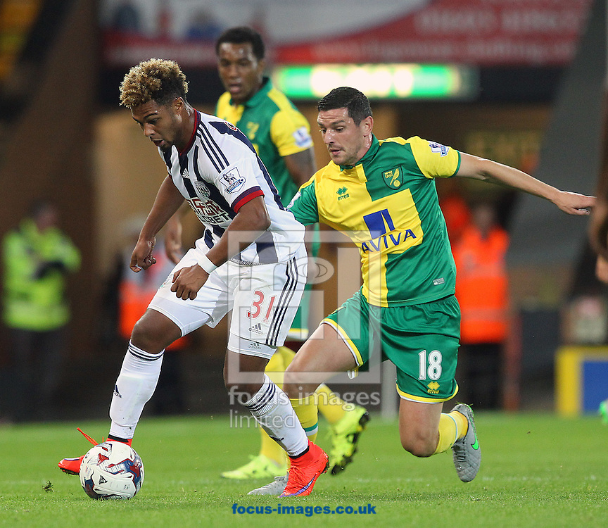 Graham Dorrans of Norwich and Serge Gnabry of West Bromwich Albion in action during the Capital One Cup match at Carrow Road, Norwich<br /> Picture by Paul Chesterton/Focus Images Ltd +44 7904 640267<br /> 23/09/2015
