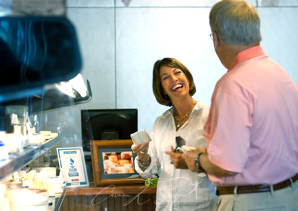 Carrie and John Rester laugh as they taste assorted gourmet cheeses May 8, 2011 at Epicure in Ocean Springs. The store carries more than 80 varieties of European cheese, along with olives, preserves, and other gift items. (Photo by Carmen K. Sisson/Cloudybright)