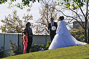 Arab Bride and groom having their wedding pictures taken at the Wohl Rose Park of Jerusalem