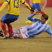 Lucas Biglia, Argentina, makes a tackle on Angel Mena, Ecuador, during the Argentina Vs Ecuador International friendly football match at MetLife Stadium, New Jersey. USA. 31st march 2015. Photo Tim Clayton