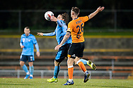 SYDNEY, AUSTRALIA - AUGUST 07: Sydney FC player Luke Brattan (26) and Brisbane Roar player James O'Shea (26) go for the ball during the FFA Cup round of 32 football match between Sydney FC and Brisbane Roar FC on August 07, 2019 at Leichhardt Oval in Sydney, Australia. (Photo by Speed Media/Icon Sportswire)