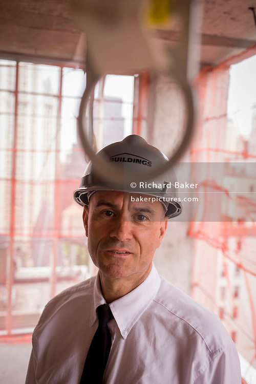 Investigative Engineering Services, Assistant Commissioner Tim Lynch inspecting a new construction site in Manhattan, New York City.<br /> <br /> From the chapter entitled 'The Skyline' and from the book 'Risk Wise: Nine Everyday Adventures' by Polly Morland (Allianz, The School of Life, Profile Books, 2015).