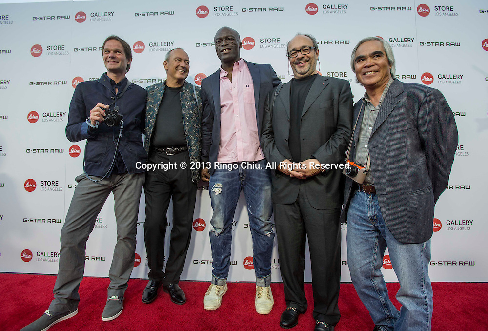 From 2nd left, CEO of Leica Alfred Schopf, song-writer and singer Seal, Chairman of Leica Andreas Kaufmann and AP photographer Nick Ut arrive at Leica Store Los Angeles Grand Opening on Thursday, June 20, 2013 in West Hollywood, California. (Photo by Ringo Chiu/PHOTOFORMULA.com)