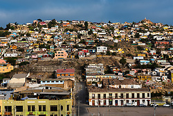 Colorful houses built on a hill in the port city of Coquimbo, Chile.