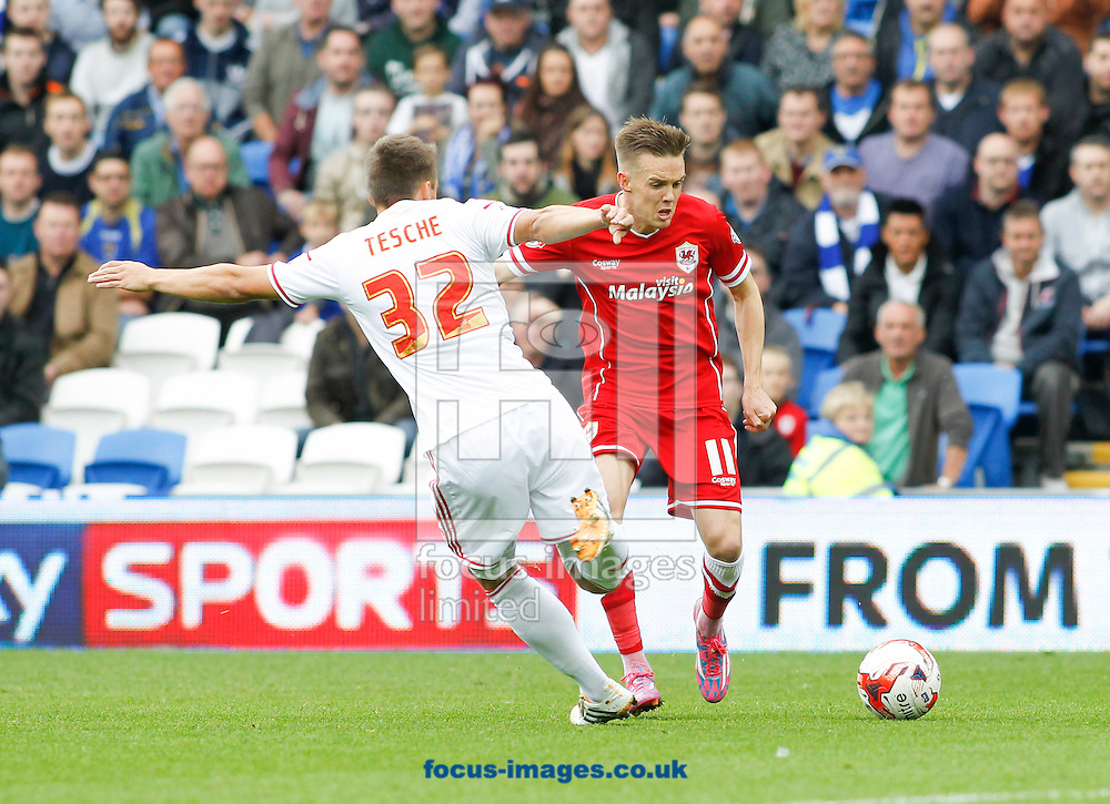 Craig Noone of Cardiff City and Robert Tesche of Nottingham Forest during the Sky Bet Championship match at the Cardiff City Stadium, Cardiff<br /> Picture by Mike  Griffiths/Focus Images Ltd +44 7766 223933<br /> 18/10/2014