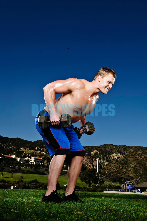 A model does various work outs for Men's Fitness photo shoot