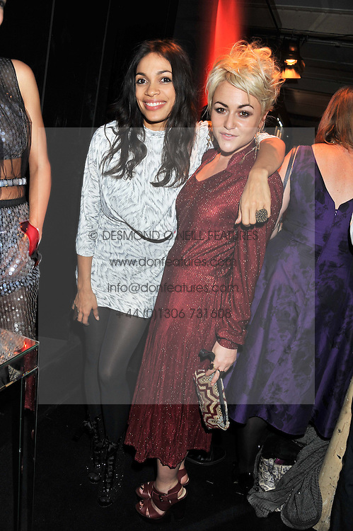 Left to right, ROSARIO DAWSON and JAIME WINSTONE at a party to celebrate the launch of the new Vertu Constellation phone - the luxury phonemakers first touchscreen handset, held at the Farmiloe Building, St.John Street, Clarkenwell, London on 24th November 2011.
