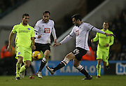 Derby County midfielder George Thorne dispossesses Brighton striker, Tomer Hemed (10) during the Sky Bet Championship match between Derby County and Brighton and Hove Albion at the iPro Stadium, Derby, England on 12 December 2015.