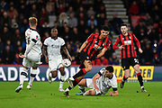 AFC Bournemouth forward Dominic Solanke (9) is challenged by Luton Town defender Matty Pearson (6)  during the The FA Cup match between Bournemouth and Luton Town at the Vitality Stadium, Bournemouth, England on 4 January 2020.