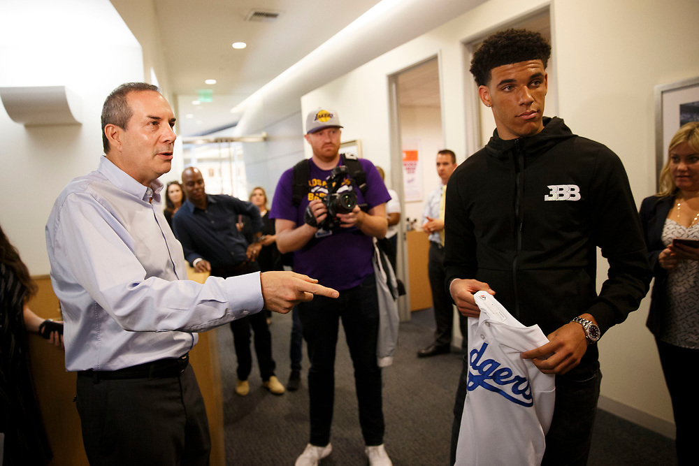 Lon Rosen, executive vice president and chief marketing officer for the Los Angeles Dodgers, presents Lakers draft pick Lonzo Ball a jersey before throwing out the first pitch at Dodger Stadium on Friday, June 23, 2017 in El Segundo, California. The Lakers selected Lonzo Ball as the No. 2 overall NBA draft pick and is the son of LaVar Ball. © 2017 Patrick T. Fallon
